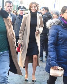 She's all class: Irina Shayk looked like the classy lady in cashmere coat and black turtle...
