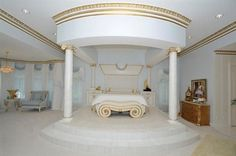 This white & gold bedroom is fit for royalty.