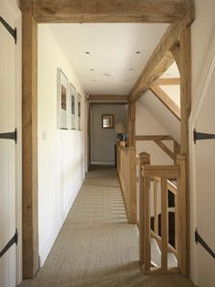Barn Doors In Hallway Hooked On Houses. 10 Barn Door Designs For Any Style Home. Ceiling Mounted Barn Door Same Opening Type As Ours Wall . Home and Family Staircase Railings, Staircase Design, Bannister, Barn Conversion Interiors, Border Oak, Oak Frame House, Cottage Interiors, Home And Deco, House Goals