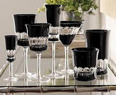 To make the pattern, black crystal is layered over clear crystal, then gently cut away to create the unique, oval-banded pattern. It makes a stunning presentation of liquors, though red wines and red cocktails look particularly elegant against the black.