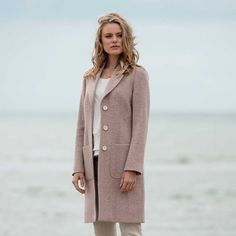 This baby-soft cashmere blend Emma coat is our most luxurious yet. Featuring an oversized herringbone weave in soft cream and dusky pink, designed and woven at our mill in Donegal, this coat the perfect thing for stepping into spring.