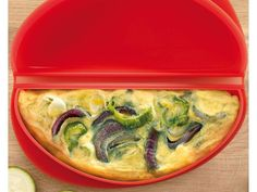 Omelette Cooker  by Lekue this is fabulous for a delicious omelet 2 minutes in microwave that's it definetly the best $15 I ever spent on cookware