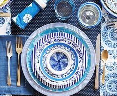 Consider Color (and Pattern)  Choosing plates in the same color scheme makes it virtually impossible for them to look mismatched—your eye (and that of your guests!) will read them as a cohesive set as long as they're all similar shades. When you're setting your table, be sure to reach for plates in a variety of patterns, layering stripes on florals on chinoiserie.