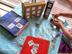 Learn with Play at Home: Create a Box City. Cutting practice and creativity for kids.