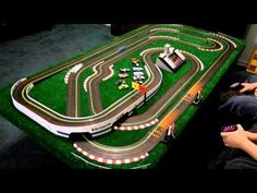 Possibly the fastest slot car track ever created enables the small ma. Game Design, Grand Prix, Hot Wheels, Video Vintage, Slot Car Tracks, Race Tracks, Party Friends, Slot Machine Cake, Cars 1