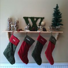 "My solution for hanging stockings without a fireplace. Made the ""w"" (pinterest idea) for $5, bought the shelf for $7, burlap base tree for $5, and found the rest around the house."