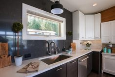 The backsplash extends to the ceiling in Blog Cabin's kitchen.