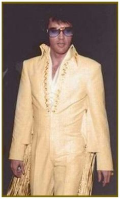 """Elvis 1970 - This might just be a problem with someone's printer or computer, but this jumpsuit is """"White"""" not """"Pale Yellow."""""""