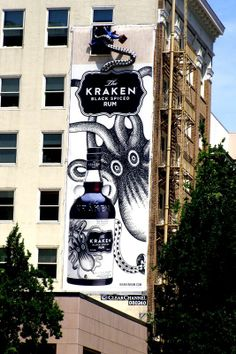 Nothing to see here. except a giant cephalopod extracting an unsuspecting office worker. Kraken Rum Co. wallscape in Portland, OR. Kraken Rum, Pushing Boundaries, Spiced Rum, Portland, Creative, Guerilla Marketing