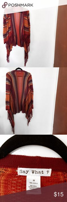 Tribal Fringe Shrug Size: M  Condition: NWOT  Color: Multi-colored - Orange/Blue, Tribal print  Style: Fringe oversized Cardigan  Brand: say what ?  Feel free to ask me any questions you may have about this listing!  ❌TRADES ❌LOWBALL OFFERS ❌OFF-POSH SALES REASONABLE OFFERS PLEASE❗️ BUNDLE & SAVE 15%❗️  ✌🏻 I always ship within 1-2 days ✌🏻 Say What? Sweaters Shrugs & Ponchos