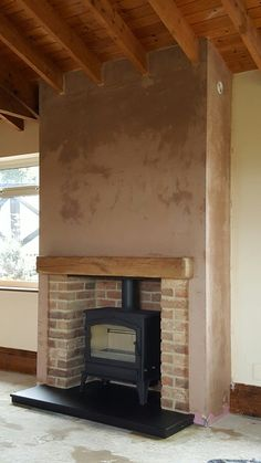 Love the look of this Woodburning stove we fitted to include false chimney breas. - Love the look of this Woodburning stove we fitted to include false chimney breast and twin wall flu - Brick Fireplace Log Burner, Home Fireplace, Fireplace Design, Fireplace Stone, Fireplace Ideas, Pallet Fireplace, Brick Fireplace Decor, Fireplace Hearth, Log Burner Living Room