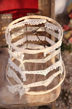 find an old bare lamp shade, tie on some lace, and use to decorate or pin things onto it.