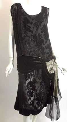 Black burnout velvet 20s dress lined in black silk with velvet swagged hip sash lined in a heavy woven gold metallic textile. Loose bow at side trimmed in tulle at  ends.