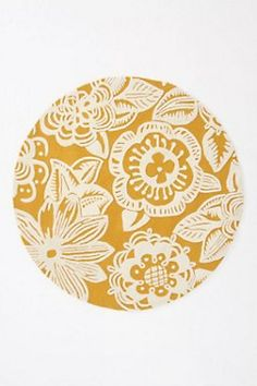 worled trapunto rug, round $500-$1000  depending on the size. love the yellow. love the flowers. love the shape. #anthro