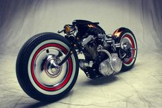 This bike is a Harley-Davidson Sportster custom by Art of Racer, it's based on a 1991 Sportster though the only parts of the original bike are the engine, transmission and carburettor. That rather unique looking frame, modified springer front-end, suicide clutch, saddle, handlebars, rear fender and fuel tank are all custom creations.