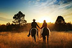 Holding hand on horseback. Cute idea for engagement photos.
