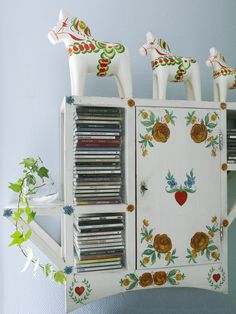 Dala horses (love the cabinet too!)