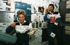 Astronauts Jan Davis and Mae Jemison eat aboard the shuttle Endeavor on Sept. 12, 1992.