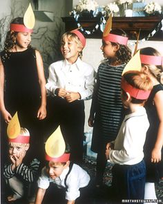 Cute idea...let the kids make flame headpieces from construction paper, then entertain the grownups with the story of the menorah.