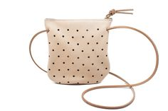 """Punched Pouch $70 This pouch keeps your can't-live-without essentials in one go-to spot (cell phone, cards, and keys) and also doubles as a quick and easy clutch or crossbody on the go!  Dimensions: Measures approximately 7.5"""" x 6.5"""".  Details: Leather is vegetable tanned, hand punched, unlined and finished with a sturdy brass zipper. Comes with a removable cross body strap.  Pine & Boon offers bag and textile designs, using the strongest upholstery, belt leathers, and hardware. Made in Seat..."""