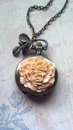 Steam Punk Flower Pocket Watch Necklace.  This is a real working pocket watch. It is about 2 inches tall. It comes on a 31 inch long antique bronze colored chain, including a lobster clasp.