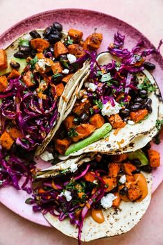 Loaded with tangy slaw and black beans, these easy sweet potato tacos are the comforting vegetarian dinner that Meatless Monday dreams are made of. Quick Recipes, Easy Healthy Recipes, Easy Meals, Delicious Recipes, Healthy Food, Mexican Food Recipes, Vegetarian Recipes, Dinner Recipes, Ethnic Recipes