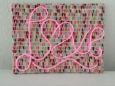 PINK NEON LOVE sign on geometric pattern frame