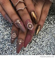 Long nails with applications and rings