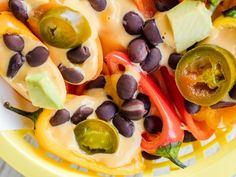 Nachos : Slice mini peppers in half lengthwise, then spoon on warm cheese sauce and your favorite nacho toppings for a corn-free alternative to tortilla chips, with even more scooping power.  Food photography and recipe by Jackie Alpers.