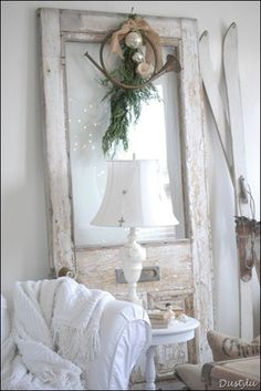 Reuse a salvaged door - lean it in the corner of the room.  It adds height and you can use it to display seasonal decor - no additional holes in the wall.