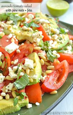 Yummy summer salad with avocado, tomatoes, pine nuts, and soft feta cheese... Delish