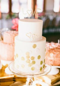 25 Supersweet and Girlie Wedding Cakes: You can never go wrong when pink meets gold, and this stunning cake is one perfect example of that.  Photo by Propel Workshops via Style Me Pretty : Decorate your cake with gold dots and letters that say love, and itll instantly be one for the books.  Photo by Ciara Richardson via 100 Layer Cake