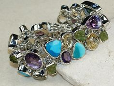 Arizona Turquoise,Amethyst Faceted,Peridot Rough bracelet designed and created by Sizzling Silver. Please visit  www.sizzlingsilver.com. Product code: BR-8188