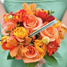 Beautiful Bridesmaids' Bouquets | Orange and Red Bouquet | SouthernLiving.com - http://www.southernliving.com/home-garden/bridesmaid-bouquet-00417000071272/page20.html