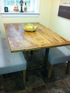 Loving my kitchen nook table...table top is from a old maple tree that fell in the yard next door and the legs are from a piece of old Army equipment