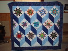No pattern.  Stars from Carol Doak and set in a tumbling block set.