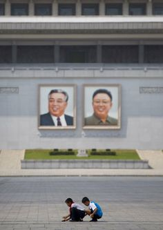 """Portraits of Kim Il Sung and Kim Jung Il are everywhere in the country, overlooking the people. It's so prominent that Lafforgue did an entire series on just the ""Great Leaders'"" portraits."""