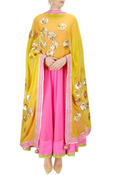 Featuring the Hot Pink Anarkali teamed with a gorgeous Mustard Yellow Dupatta with delicate Gota work in floral patternPerfect for Sangeet, MehendiDetails : Anarkali - Georgette and DupionLeggings - LycraDupatta - GeorgetteAll products can be c. Indian Suits, Indian Dresses, Indian Wear, Indian Clothes, Punjabi Suits, Ethnic Trends, Desi Wear, Indian Couture, Pakistani Outfits