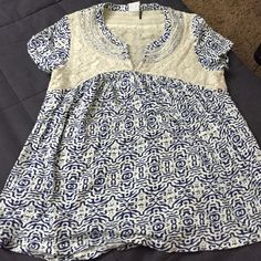Anthropologie shirt, nwot Blue and cream baby doll shirt with lace detailing, never worn Anthropologie Tops Tunics
