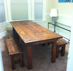 I want a farm table like this someday in my kitchen.  I at least want benches on one side... maybe a bench on one side and chairs on the other!!