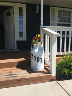 Old milk can painted and potted.