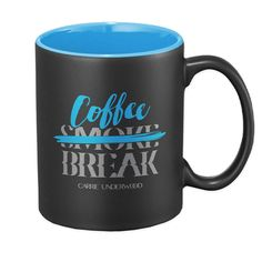 Black 11 oz. ceramic coffee mug with smooth rim and glossy blue interior. Dishwasher safe, but recommend hand washing to prolong the design.