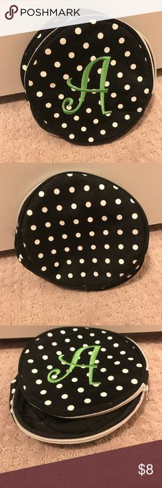 "The Letter ""A"" polka dot round jewelry/makeup bag The Letter ""A"" monogrammed in green on a round black with white polka dots Jewelry/makeup bag. Used to hold my jewelry. Bags Cosmetic Bags & Cases"