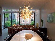 Modern & unique dining room chandeliers combined with oval dining table | Decolover.net