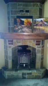 Corner wood burning stove fireplace with mantel for basement Little House, Rustic Cabin, Wood Pellet Stoves, Home Remodeling, Corner Fireplace, Stone Mantel, Fireplace Mantels, Fireplace, Wood Stove Fireplace