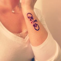 Side of wrist tattoo. Infinity symbol with mom, dad, and brother's initials