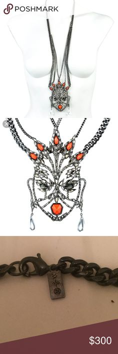 """NEW ALEXIS BITTAR TRIBAL MASK Long Necklace Layering influences from Art Deco and Cubist aesthetics, this chain draped long pendant necklace features a gorgeous mask in Ruthenium metal work whose face is formed by smoky and bright orange Crystals along with Smokey Pyrite Doublets and is finished with a pair of Hand Carved and Hand Polished dew drop earrings that flutter with movement. Pendant measures approximately 3""""W x 4.75""""L and total Length of necklace is approx. 19.5"""". RETAIL $395…"""