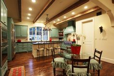 Love the turquoise/aqua cabinetry and the hardwood floors!