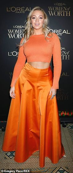 Iskra Lawrence was putting on a defiant display when she attended the L'Oreal Women of Worth at the Pierre Hotel in Midtown, New York City on Wednesday. Sweater Dress Boots, Wrap Sweater, Sweater Outfits, Cute Outfits, Iskra Lawrence, White Midi Skirt, Womens Worth, Victoria's Secret, Summer Sweaters