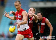 Round 1 - Adam Cooney tackles Ted Richards